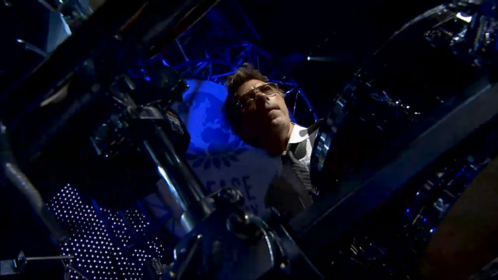 John, surrounded by his percussion kit, on stage in 2010.