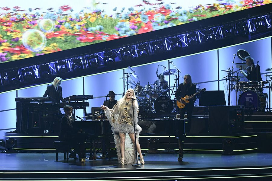 Adam Chester accompanying Kesha and The EJ Band on piano (Photo: Michele Crowe/CBS)