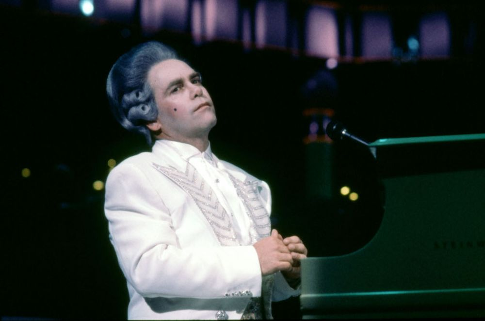 Elton john dressed as Mozart in a costume designed by Bob Mackie