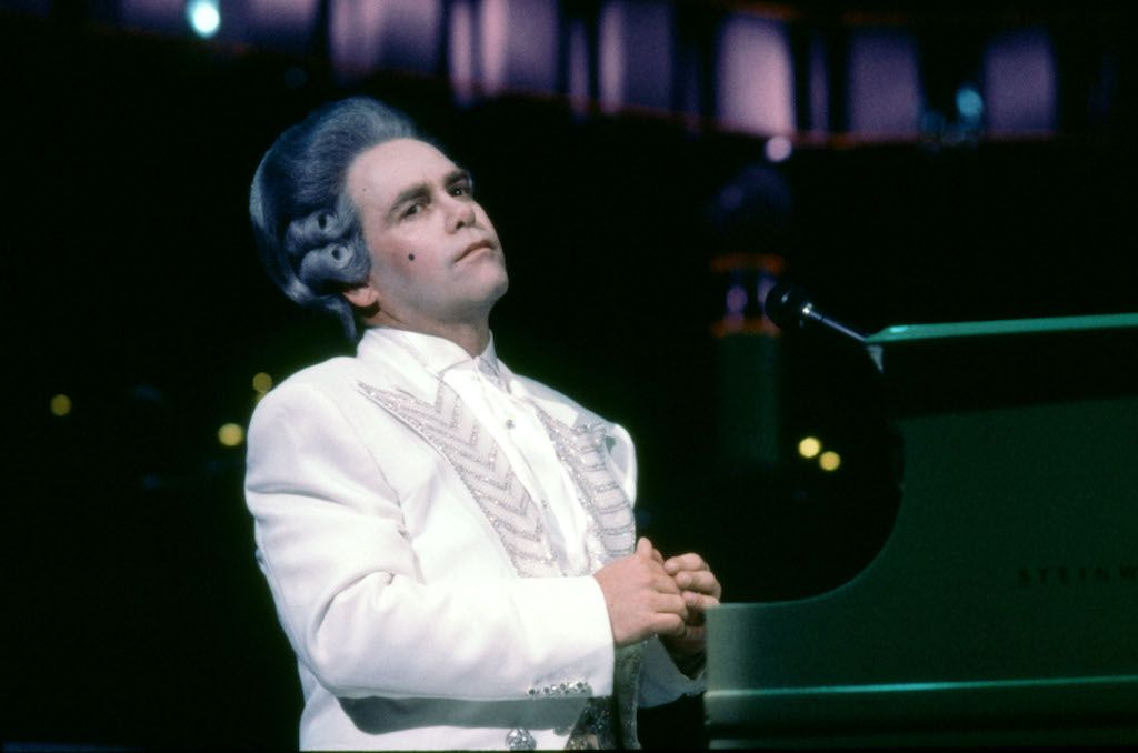December 1986 - Elton john dressed as Mozart in a costume designed by Bob Mackie on the tour of Australia with the Melbourne Symphony Orchestra.