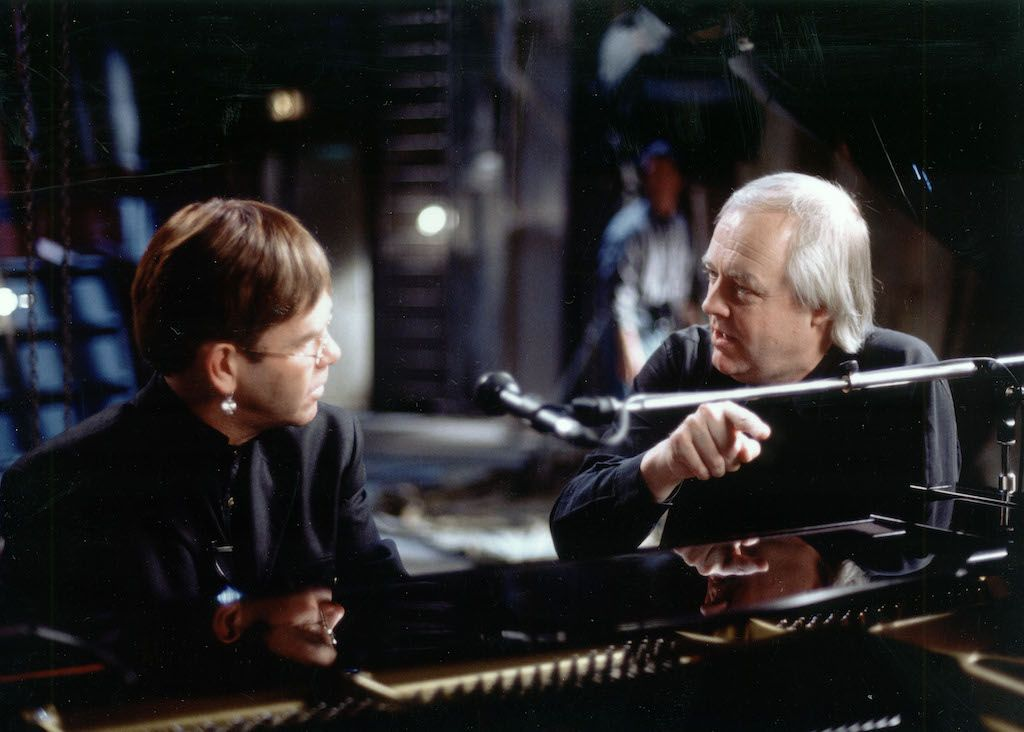 Elton John and Tim Rice in the recording studio.