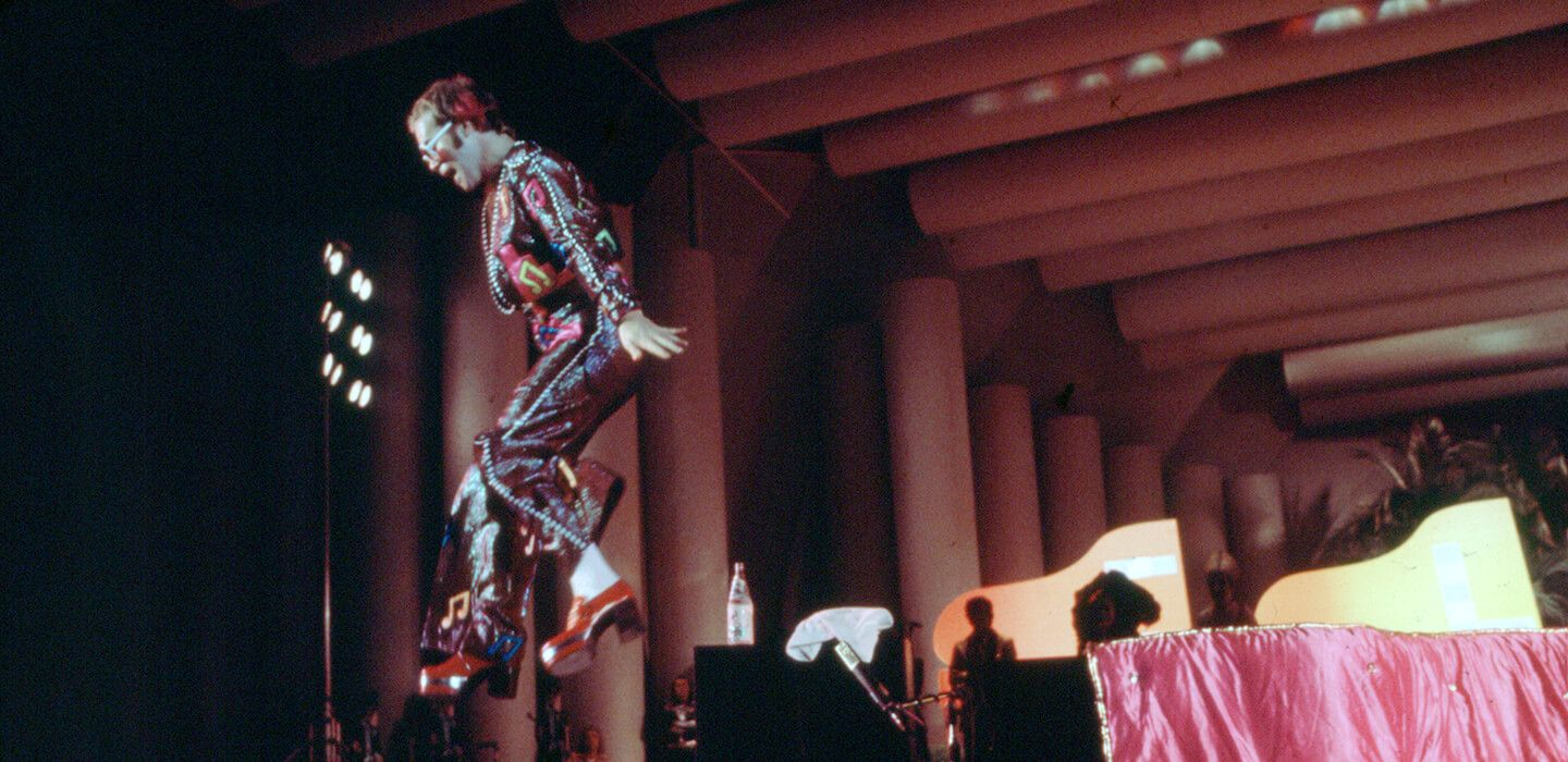 Elton playing his show at the Hollywood Bowl on September 7th, 1973. (Photo: Ed Caraeff @ Iconic Images)