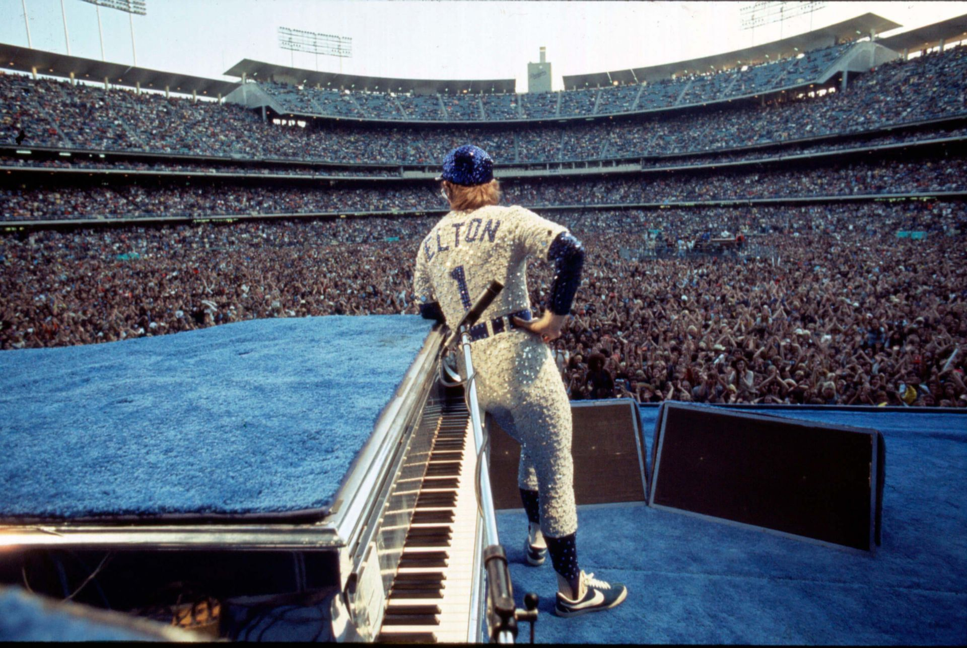 October 1975 - Elton John posing for the crowd at Dodger Stadium, Los Angeles. (Terry O'Neill @ Iconic Images)