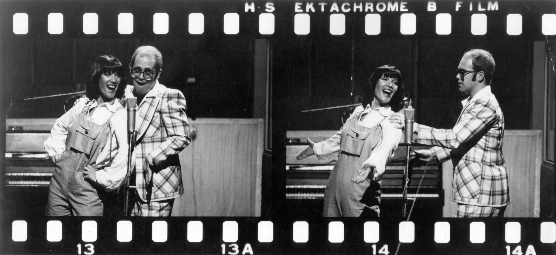 "Elton and Kiki Dee on the set of the music video for ""Don't Go Breaking My Heart""."