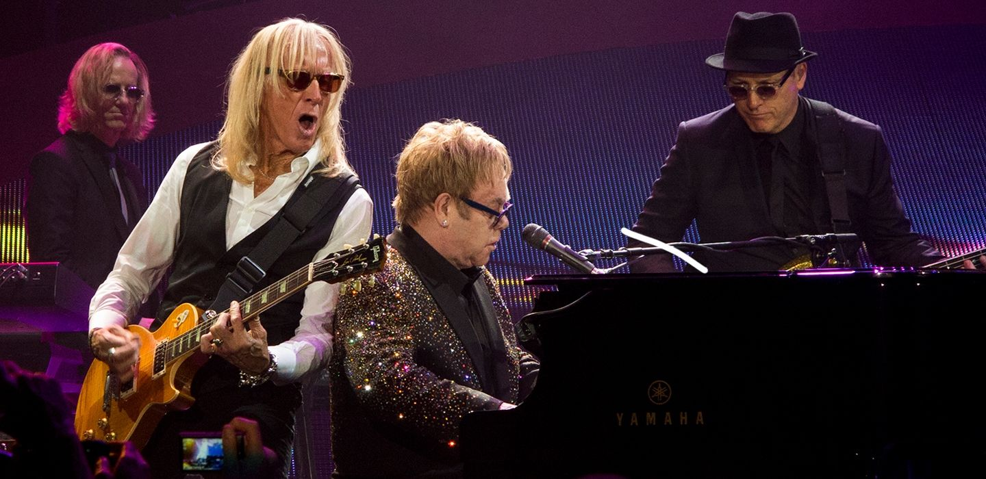 Davey and Kim (far left), on stage with Elton and bass player, Matt Bissonette. (Photo: Jim Pietryga)