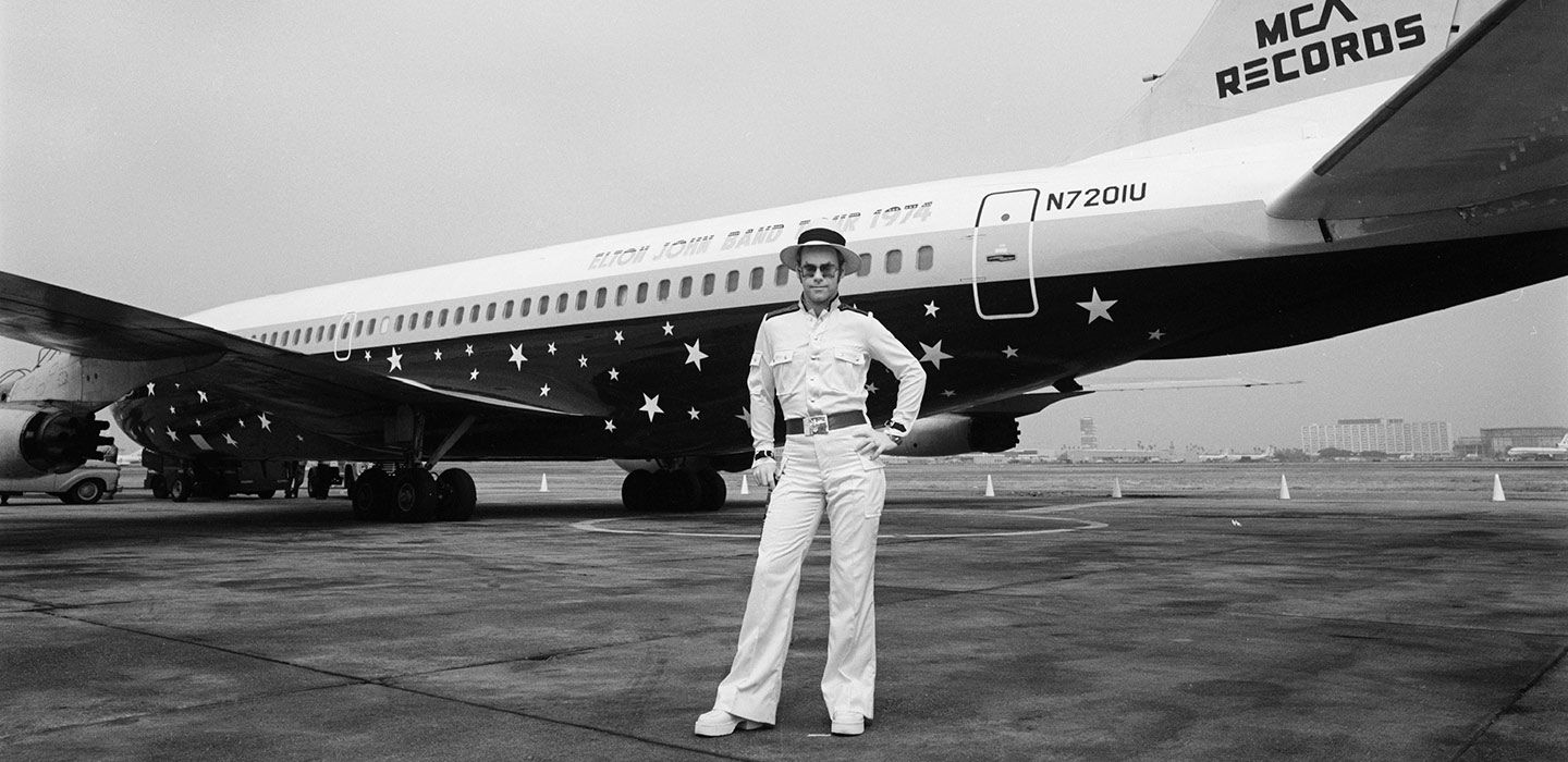 Elton in front of the Starship at Los Angeles Airport's Charter Terminal. (Photo: Sam Emerson)