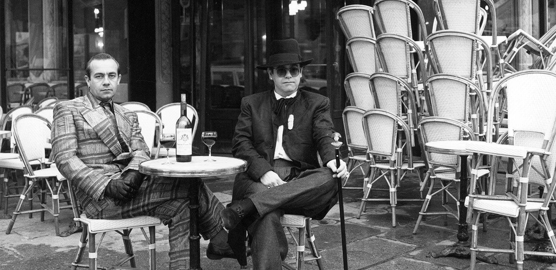 Elton and Bernie in front of Les Deux Magots cafe in Saint-Germain-des-Prés, Paris. (Photo: Terry O'Neill @ Iconic Images)