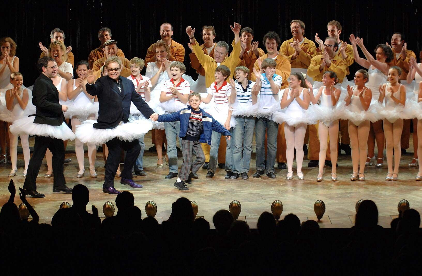 Elton on stage with the cast of Billy Elliot.